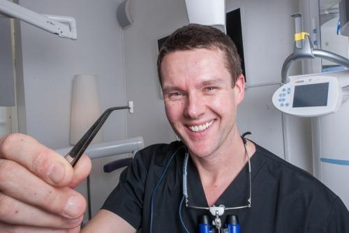 Man holding implant